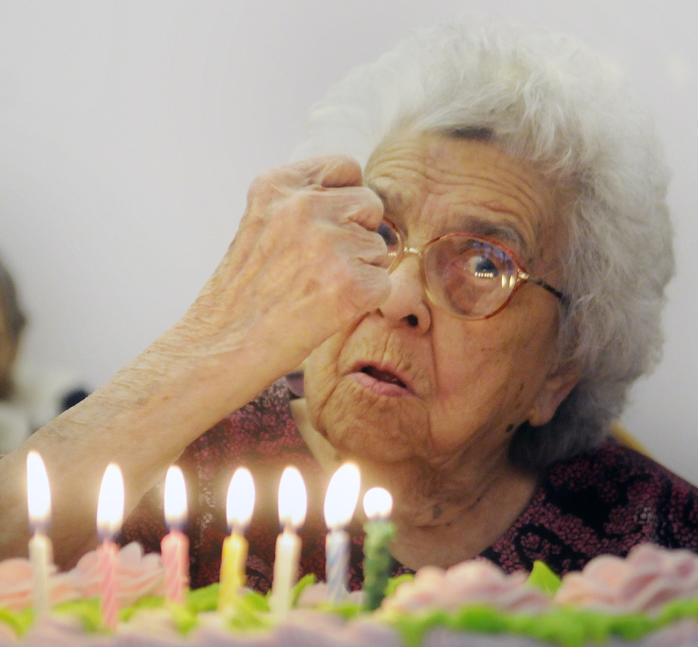 Though partially deaf, Gertrude Virgin encouraged everyone to quiet down Sunday before she blew out the candles of the cake for her 106th birthday in Gardiner. Friends and family celebrated the milestone with cake and cards.