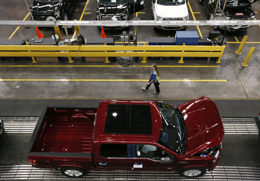 In this Nov. 11, 2014, file photo, 2015 Ford F-150 trucks are produced at the Dearborn Truck Plant in Dearborn, Mich. Six years after its financial system nearly sank and nearly that long since the recession ended, the United States seems poised to grow in 2015 at its fastest pace in a decade.