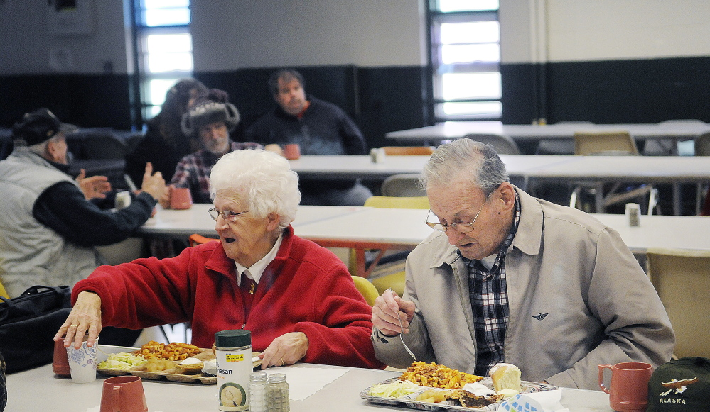 Rita Doyon, 82, and Burt Poulin, 94, eat lunch at the Winthrop Hot Meals Kitchen at the St. Francis Parish Hall in Winthrop on Monday. The kitchen recently had to discontinue lunch on Fridays because of a shortage of volunteers.