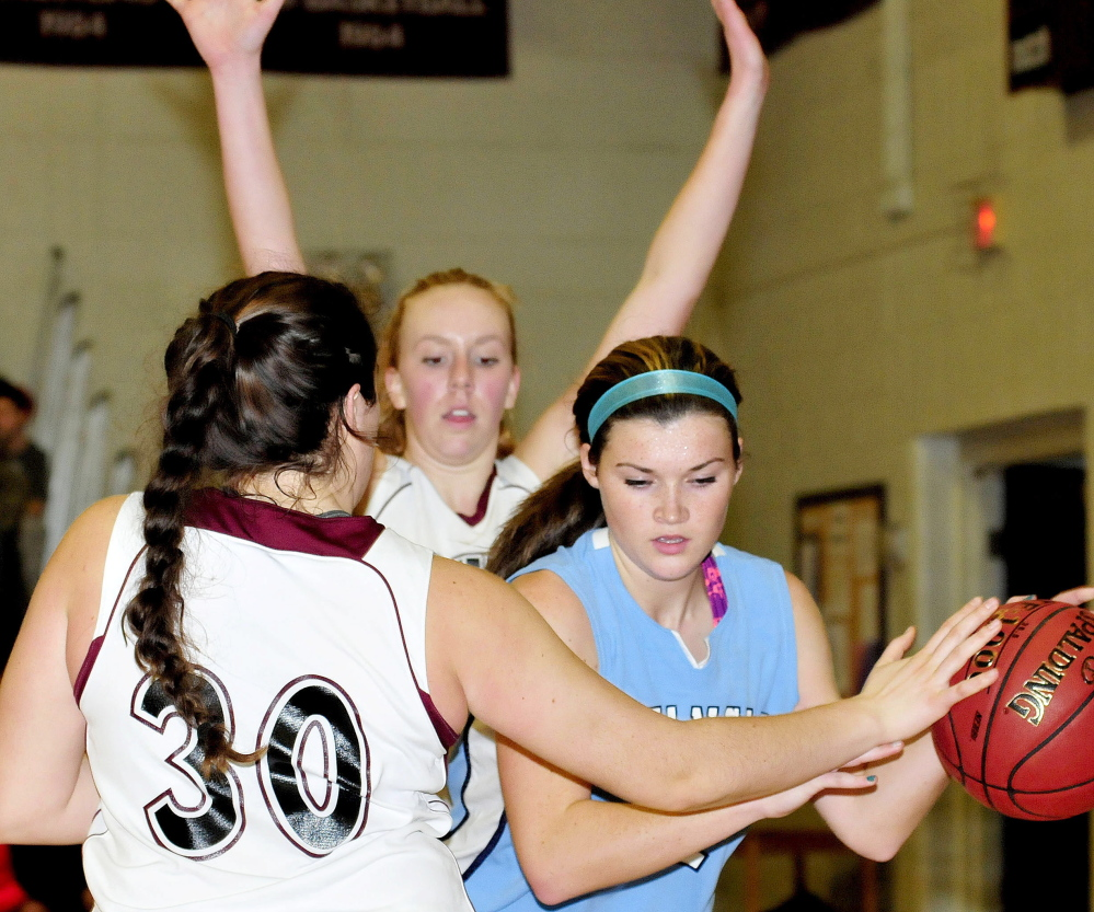 Maine Central Institute's Katie Hughes, left, and Cassie Miller pressure an Oceanside player during game on Monday.