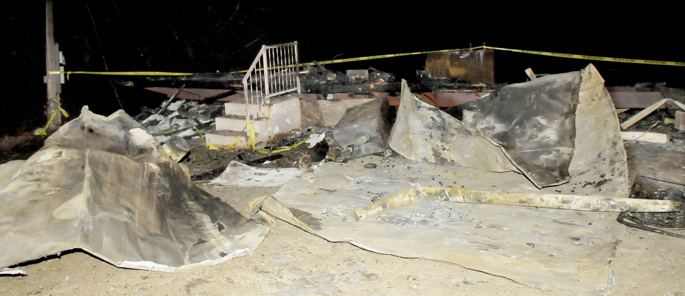 The flattened remains of a mobile home on Landry Place off the Crowell Road in Unity on Tuesday. The home was destroyed by fire last Sunday night.