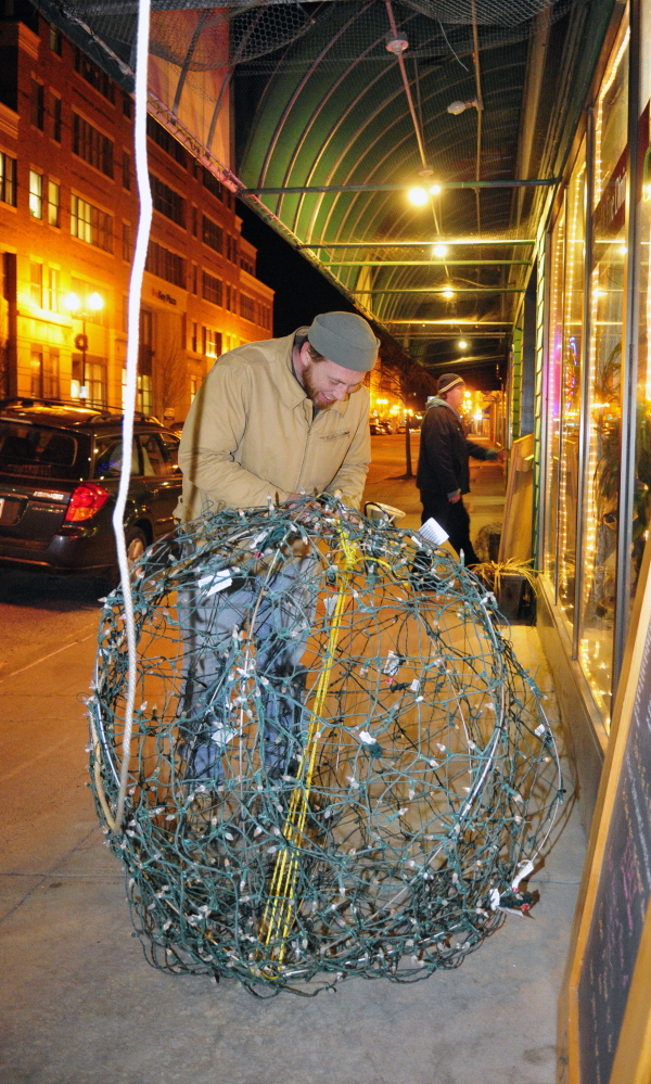 Jason McFarland prepares the New Year's Eve ball on Tuesday at Gagliano's Bistro on Water Street in Augusta.