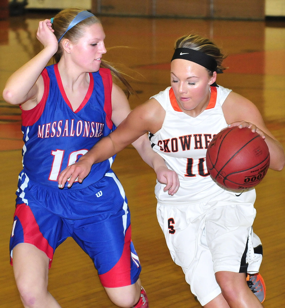 Messalonskee's Taylor Poissonnier attempts to block Skowhegan's Eliza Bedard during a game on Tuesday.