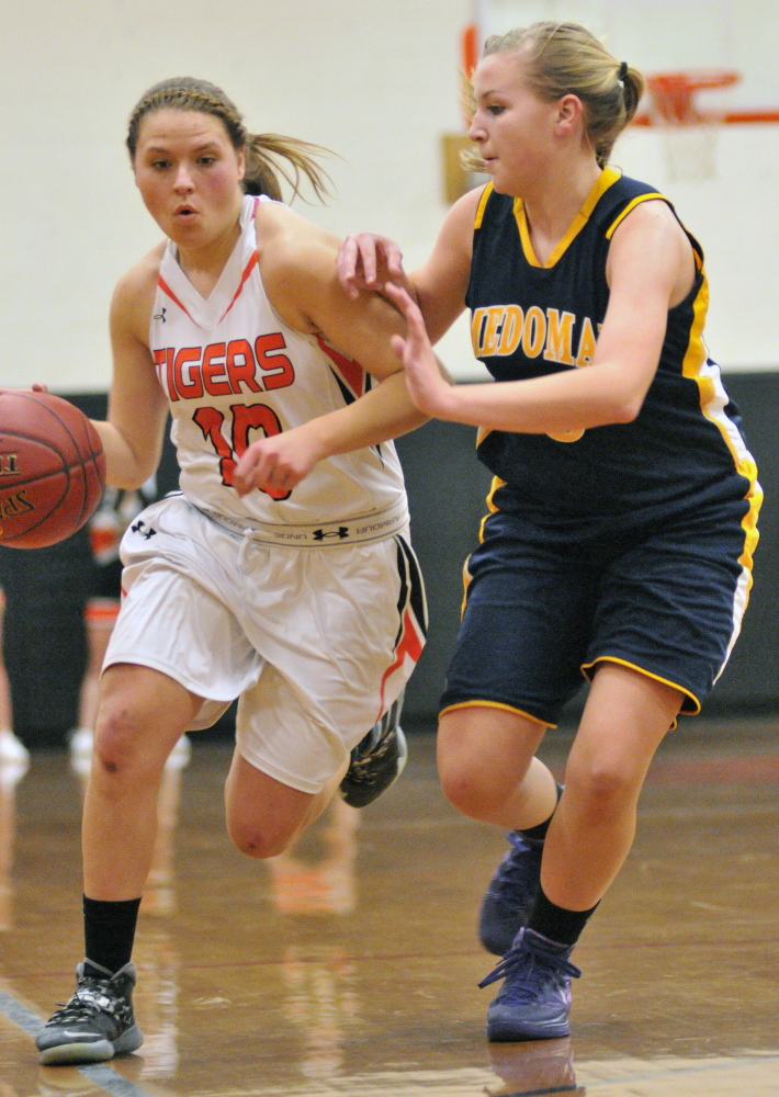 Gardiner's Morgan Carver, left, tries to get past Medomak Valley's Gabby DePatsy during a game Tuesday in the John A. Bragoli Memorial Gym at Gardiner Area High School.
