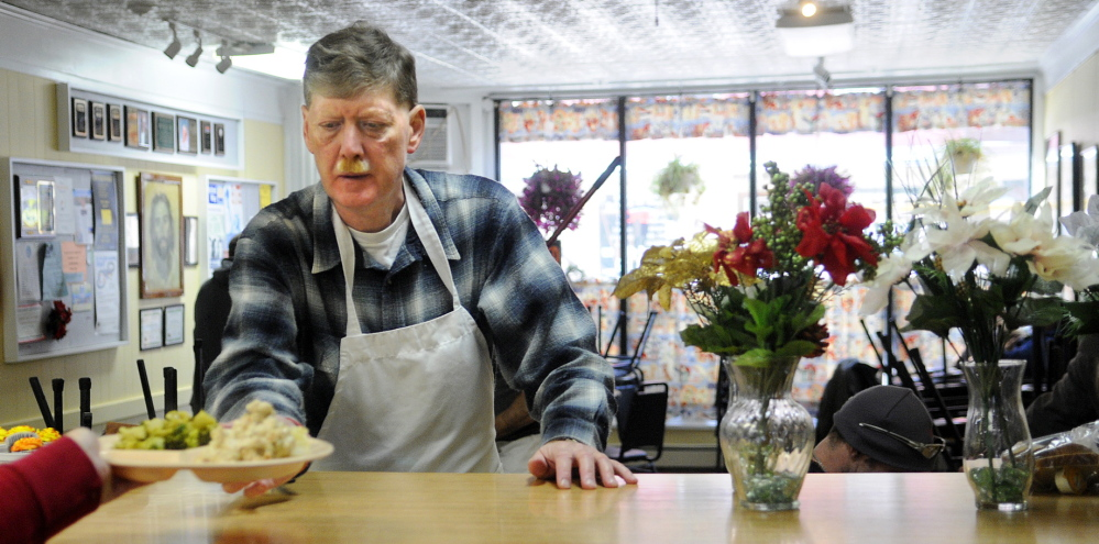 The Bread of Life soup kitchen in downtown Augusta served 2,000 more meals in 2014 than it did in 2013. In this file photo, Roy Rabe gets ready to serve a meal at the soup kitchen.