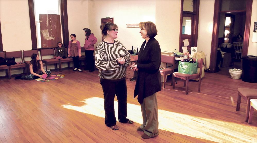 Children's Cottage business owner Karen Lewia, right, speaks with tenant Midge Pomelow, of Midge's Theater Arts Studio, in the Skowhegan building where Lewia intends to offer space to other businesses in 2015.
