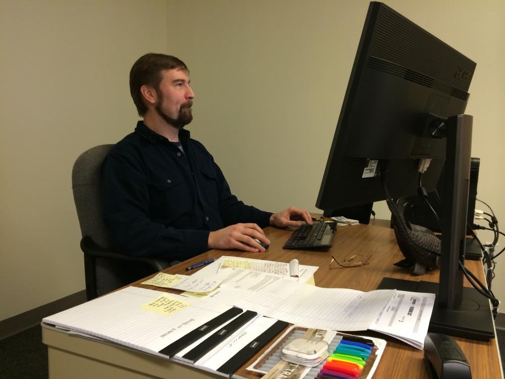 Nate Rudy, executive director of Waterville Creates!, settles in Wednesday at his new office in The Center on Main Street in Waterville. Rudy is the first director of the new nonprofit group and says he hopes to unite area arts and cultural groups in the new year.