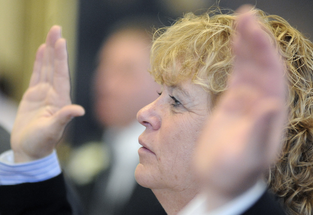 Republican Cathy Manchester of Gray was sworn into a provisional Senate seat by the Republican majority until the disputed results of her District 25 race against Democrat Cathy Breen are reviewed. Andy Molloy/Kennebec Journal