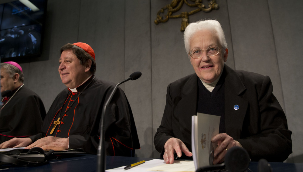 Sister Sharon Holland, right, arrives for a news conference at the Vatican on Tuesday. The Associated Press