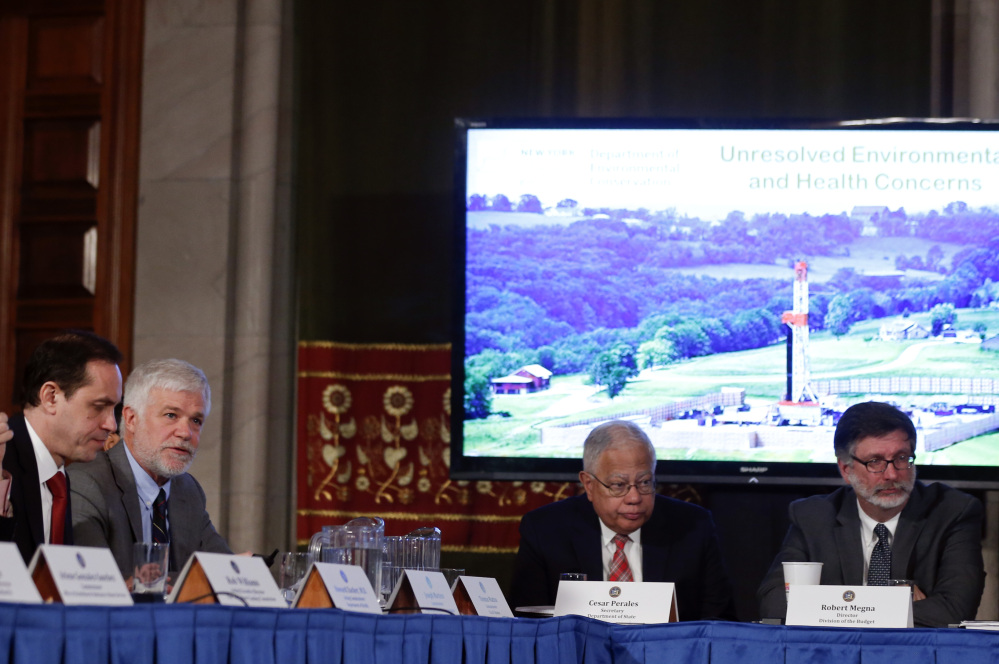 New York State Department of Environmental Conservation Commissioner Joseph Martens, second from let, talks about hydraulic fracturing during a Cabinet meeting at the Capitol on Wednesday in Albany. Gov. Andrew Cuomo's administration will move to prohibit fracking in the state, citing unresolved health issues and dubious economic benefits of the widely used gas-drilling technique. Acting health commissioner Dr. Howard Zucker is seated at left. The Associated Press