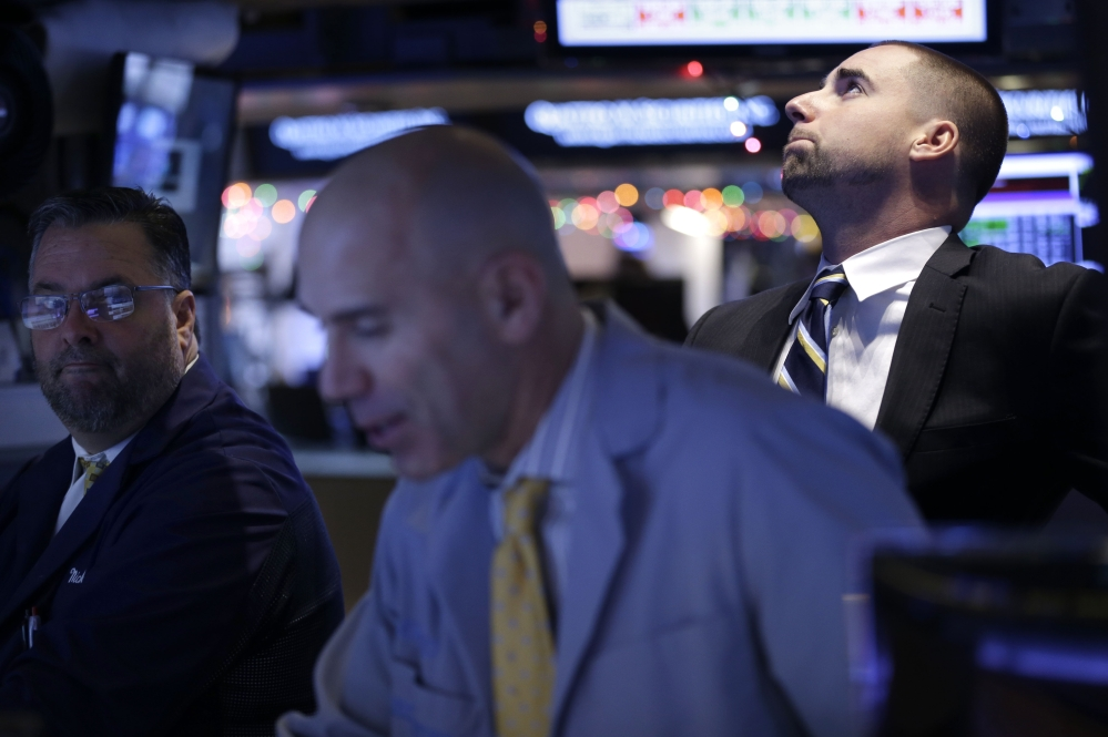 Traders work on the floor at the New York Stock Exchange in New York on Thursday. Even the energy sector advanced, despite another drop in the price of oil, as bullish earnings from the technology giant Oracle help drive the rally.  The Associated Press