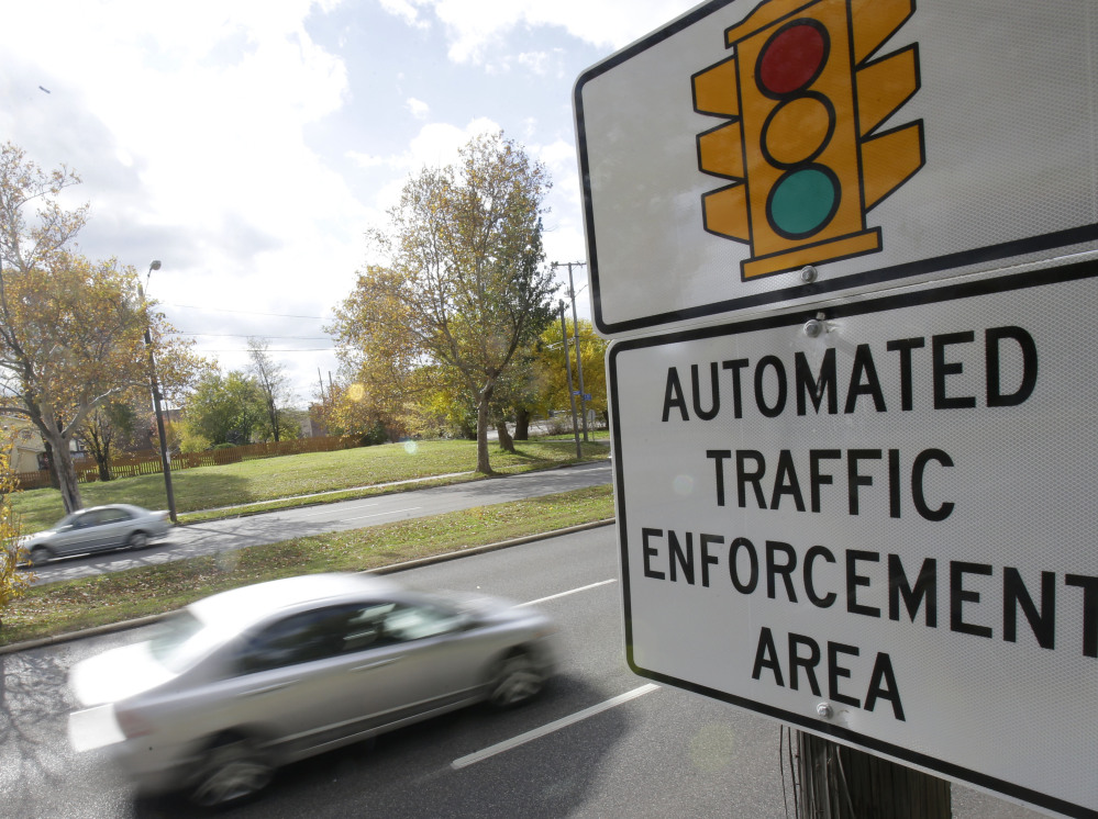 A sign warns of upcoming traffic cameras in Cleveland. A divided Ohio Supreme Court on Thursday again upheld use of traffic camera enforcement by the state's municipalities.  The Associated Press