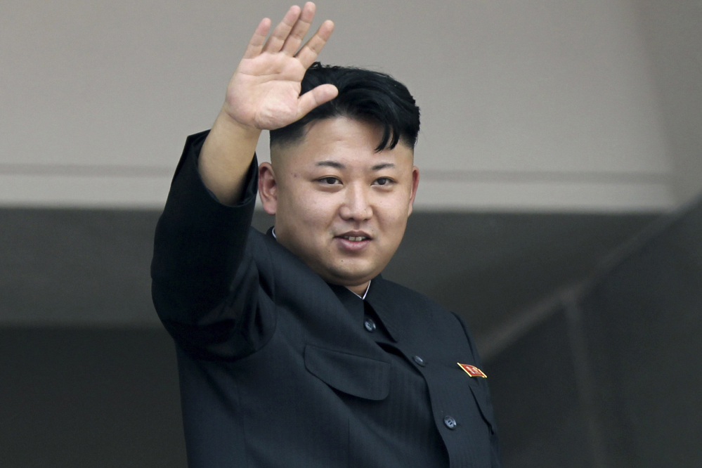 North Korea's leader Kim Jong Un waves to spectators at a military parade. The Associated Press