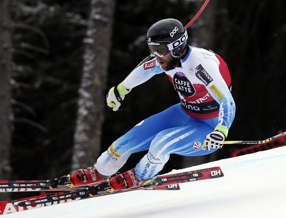 Travis Ganong speeds down the course on his way to win an Alpine men's World Cup downhill, in Santa Caterina Valfurva, Italy, on Sunday. The Associated Press