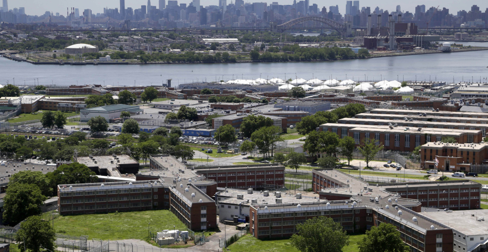 "Mere miles from New York City's skyscrapers, Rikers Island sits by itself on the East River, a 10-jail facility where an average of 11,000 inmates a night – men, women and youths – are detained on charges ranging from trespassing to murder. ""It's a world on its own there,"" says a former inmate. The Associated Press"