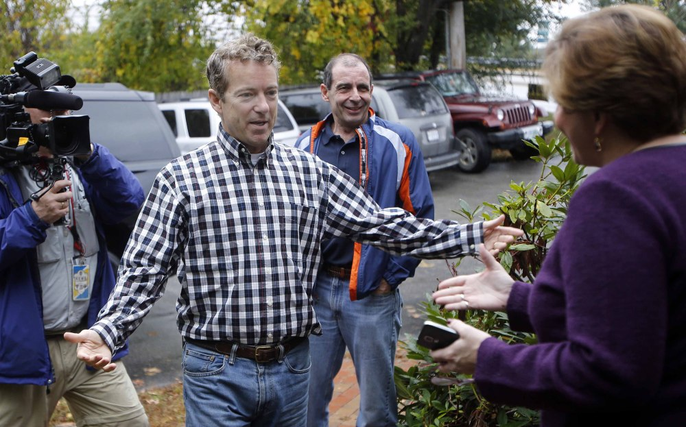 Sen. Rand Paul, R-Ky., seen greeting state Republican Chair Jennifer Horn in Concord, N.H., is showing an ability to appeal to minorities and young people. The Associated Press