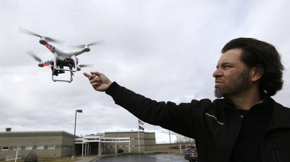 Jon McBride, who designs and builds drones with Digital Defense Surveillance, flies a training drone for members of the the Box Elder County Sheriff's Office search and rescue team, during a demonstration in February in Brigham City, Utah. 2014 File Photo/The Associated Press