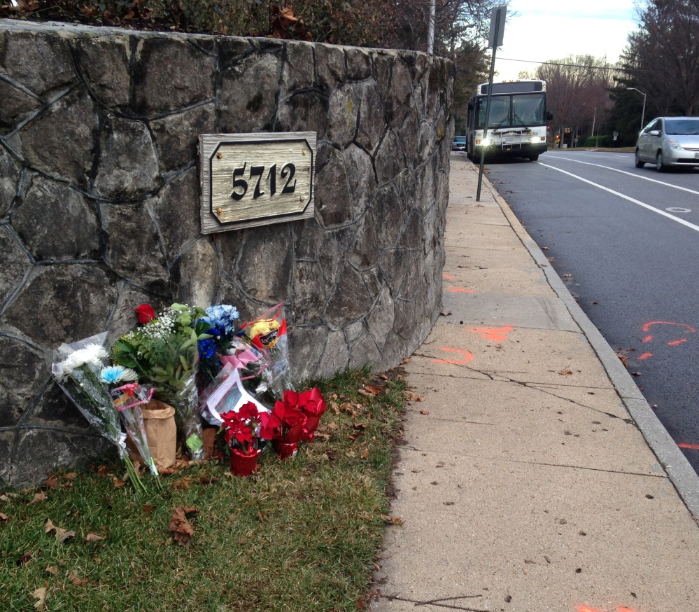 "Flowers mark the site where a bicyclist was hit Saturday in Baltimore. An Episcopal bishop returned ""to take responsibility for her actions,"" one of her peers says. The Associated Press"