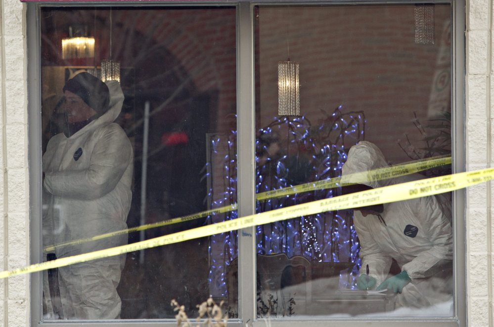 Police investigate a scene where a car rammed a truck and damaged a restaurant in Fort Saskatchewan, Alberta, on Tuesday. Edmonton City Police Chief Rod Knecht spoke Tuesday about multiple homicides that took place at different scenes overnight in Edmonton, Alberta. The Associated Press/The Canadian Press
