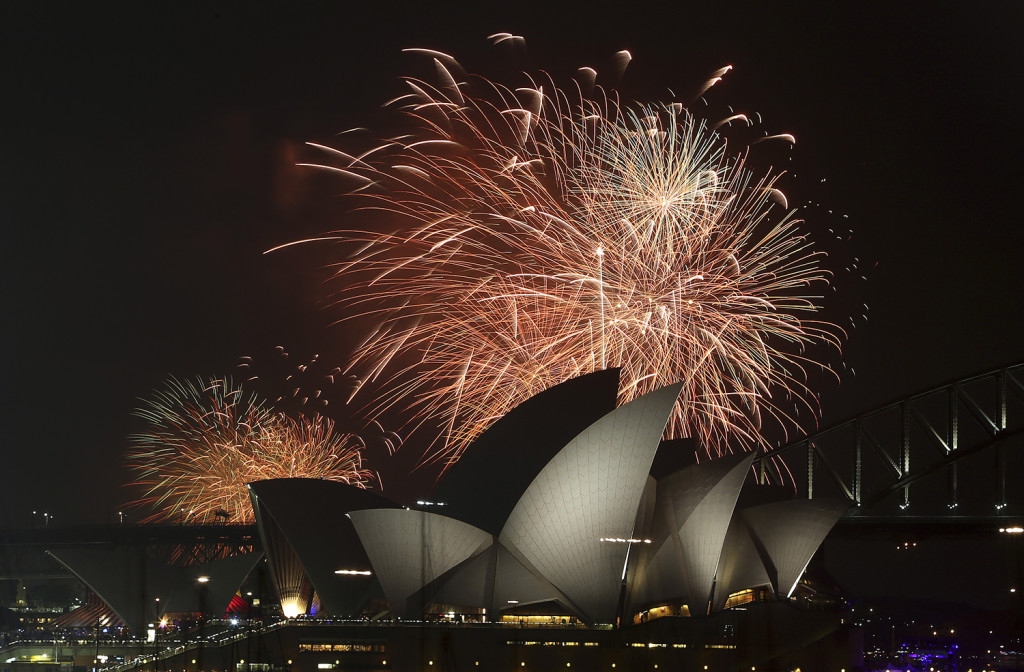 Fireworks explode over the Opera House and the Harbour Bridge during New Years Eve celebrations in Sydney, Australia, Wednesday. The Associated Press