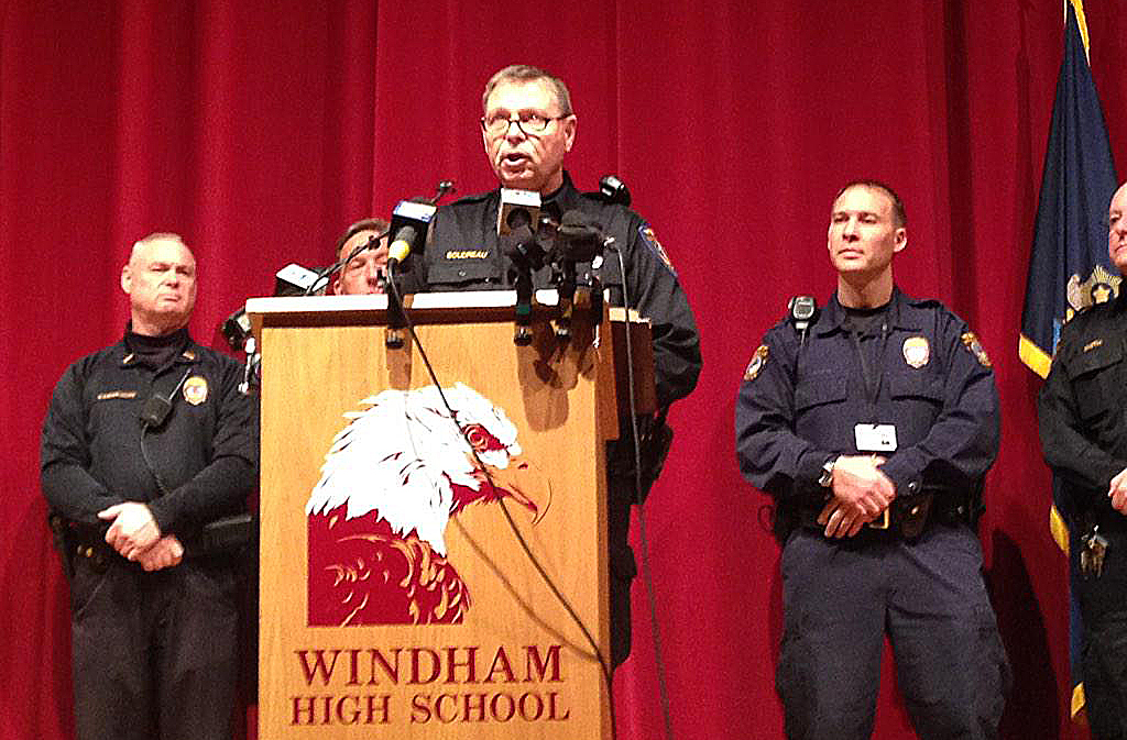 Windham police Lt. Jim Boudreau announces details of the case at a news conference at the high school Wednesday morning.. He said the suspect is charged with one count of felony terrorizing for each school that was shut down. Photo by Gillian Graham / Staff Writer