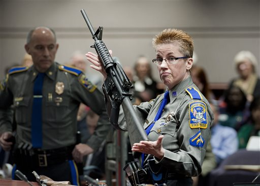 Firearms training unit Detective Barbara J. Mattson, of the Connecticut State Police holds a Bushmaster AR-15 in this  Jan. 28, 2013, photo. It is the same make and model of the gun used by Adam Lanza in the Sandy Hook School shooting. The Associated Press