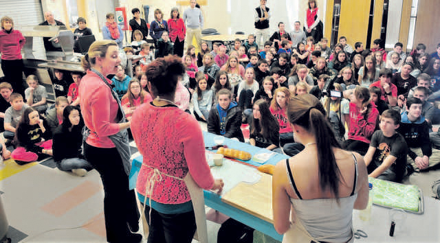 Students and staff members of Skowhegan Area Middle School watch as Amy Driscoll, left, of the King Arthur Flour Co., conducts a workshop on baking bread Tuesday at the school. Assisting are students Shaneka Sapienza, center, and Katelin Warren.
