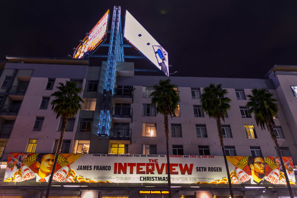 """A banner advertising the film """"The Interview"""" hangs at Arclight Cinemas in the Hollywood section of Los Angeles on Dec. 17, before Sony Pictures canceled the film's release. The Associated Press"""