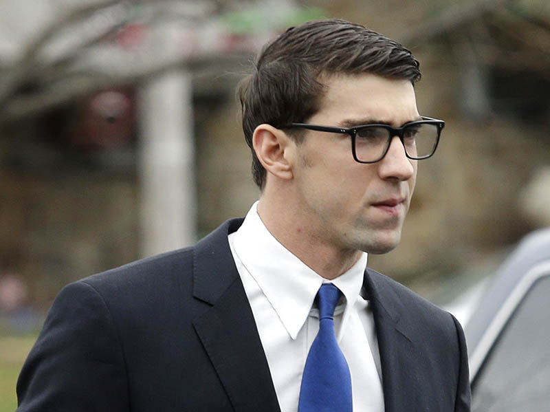 Olympic swimmer Michael Phelps walks into a courthouse for a trial on drunken driving and other charges, on Friday. The Associated Press
