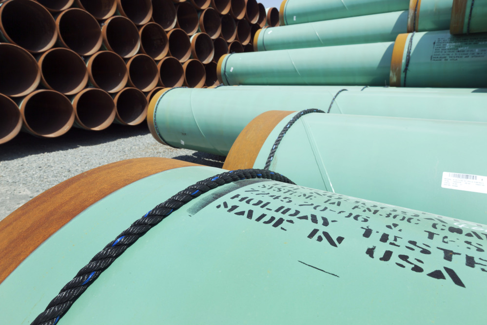 In this May 24, 2012, photo, about 500 miles worth of coated steel pipe manufactured by Welspun Pipes Inc. for the Keystone oil pipeline is stored in Little Rock, Ark. The Associated Press