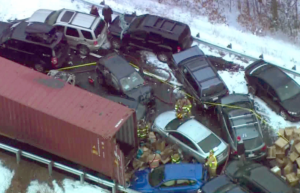 Emergency personnel work the scene along Interstate 93 near Ashland, N.H., where at least 35 vehicles were involved in two pileups after some fast-moving snow squalls Friday, in this frame grab made from aerial video.