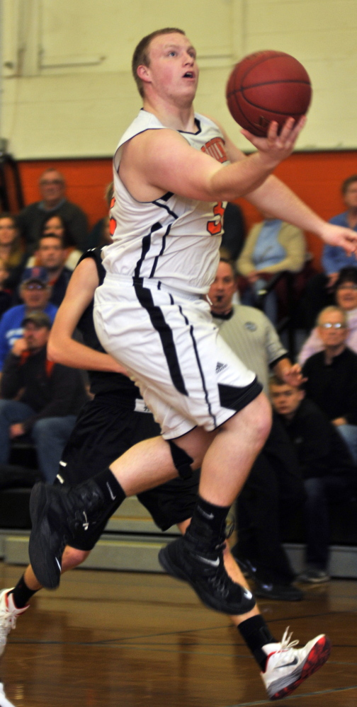 Gardiner's Brad Weston goes up for a shot during a game Friday at Gardiner Area High School.