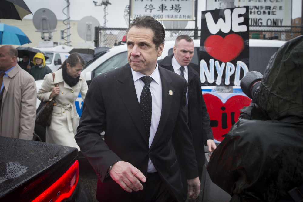 New York Gov. Andrew Cuomo leaves the wake of New York Police Department officer Wenjian Liu at the Aievoli Funeral Home, Saturday, in the Brooklyn borough of New York. Liu and his partner, officer Rafael Ramos, were killed Dec. 20 as they sat in their patrol car on a Brooklyn street.