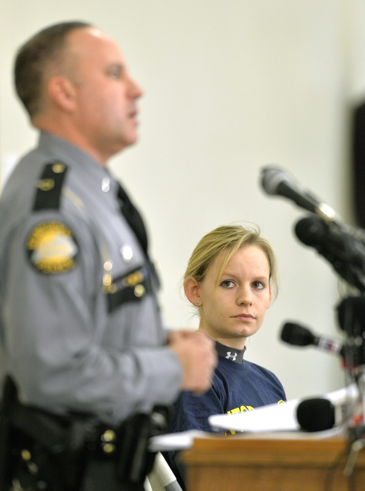 Heidi Moats, right, a National Transportation Safety Board investigator, listens as Kentucky State Police Lt. Brent White speaks at a news conference Sunday in Eddyville, Ky.