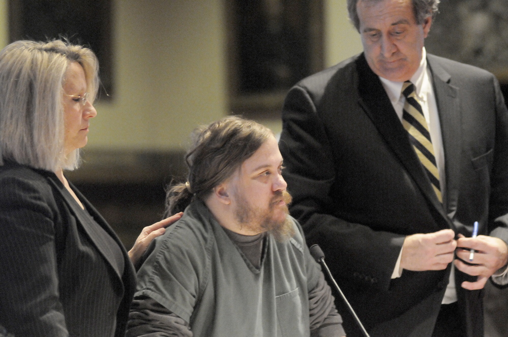 Eric Bard is flanked Monday by his attorneys, Gina Yamartino and Ronald Bourget, during a hearing at Kennebec County Superior Court in Augusta.