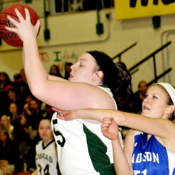 Carrabec's Emma Pluntke, left, grabs ball from Madison's Aly LeBlanc during Monday's game in North Anson.