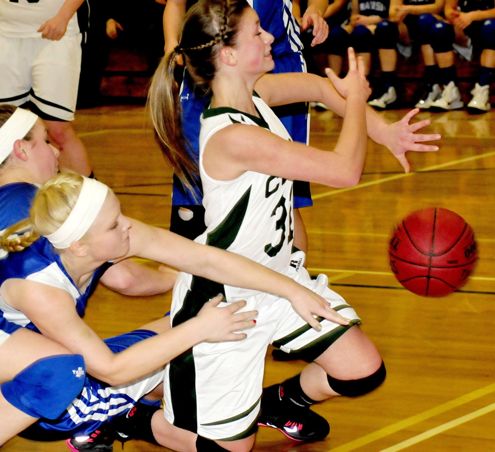 Jerzee Rugh, right, goes after a loose ball as Madison's Madeline Wood tries to stop her during Monday's game in North Anson.
