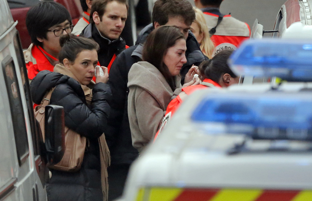 People are evacuated outside the French satirical newspaper Charlie Hebdo's office, in Paris, Wednesday.
