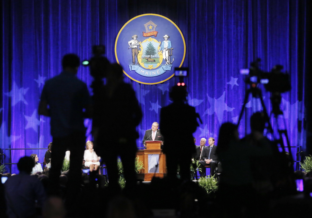 Hidden by silhouettes of news videographers, Gov. Paul LePage delivers his inaugural address Wednesday at the Augusta Civic Center. The Republican promised – among other goals on his agenda – to reduce Maine's public assistance program.