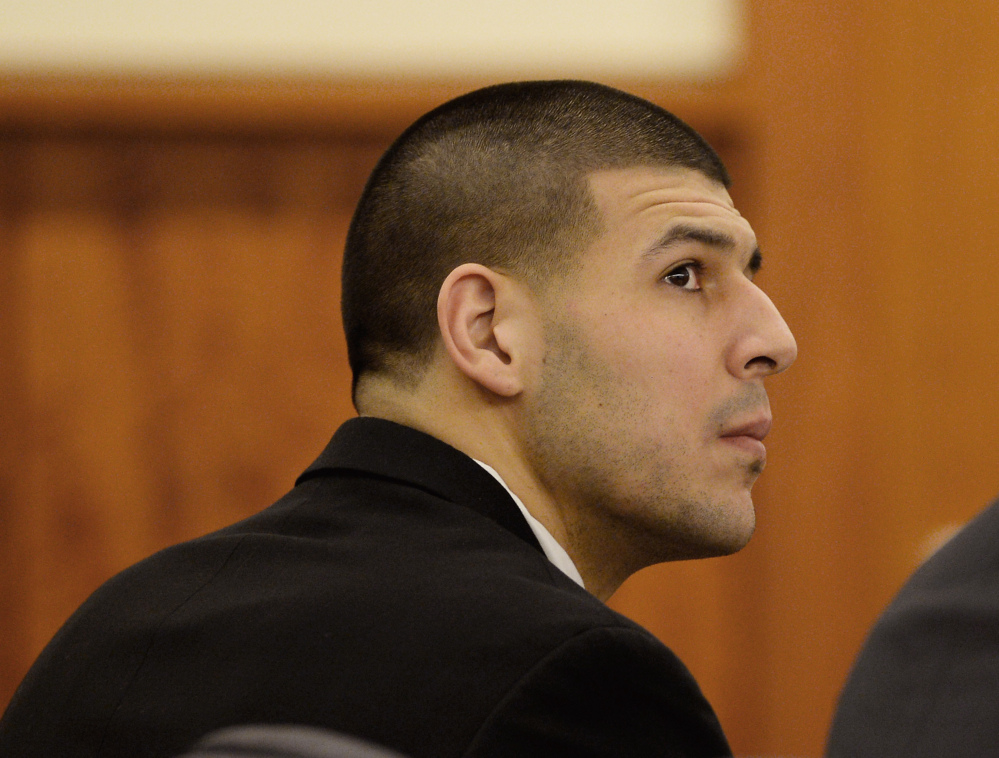 Former New England Patriots football player Aaron Hernandez attends a pretrial hearing in the first of two murder cases against him at Bristol County Superior Court in Fall River, Mass., on Tuesday.