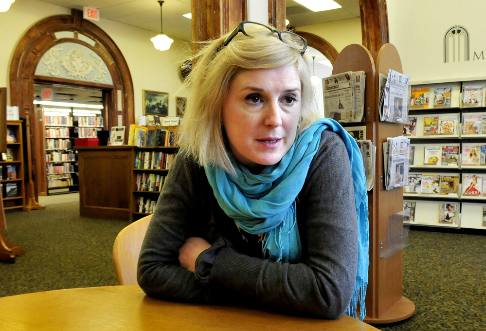 Staff photo by David Leaming Sarah Sugden of the Waterville Public Library speaks about the use of the library by homeless people seeking shelter from the cold on Wednesday.