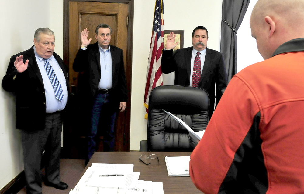 Somerset County Commissioners take the oath of office Wednesday. From left are Lloyd Trafton, Newell Graf Jr. and Dean Cray.
