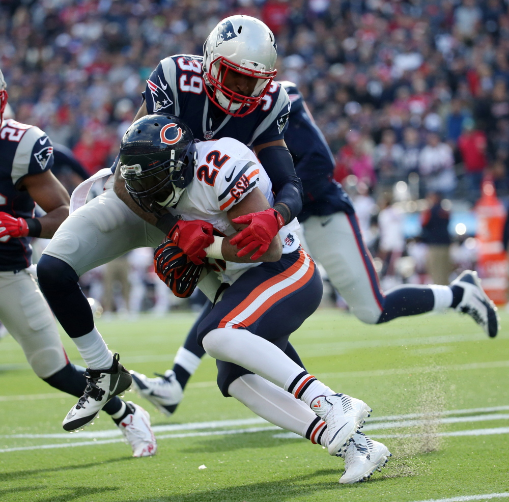 Chicago Bears running back Matt Forte (22) is tackled by New England Patriots cornerback Brandon Browner (39) in the second quarter during a recent game. The Patriots play the Baltimore Ravens on Saturday in the AFC divisional round.