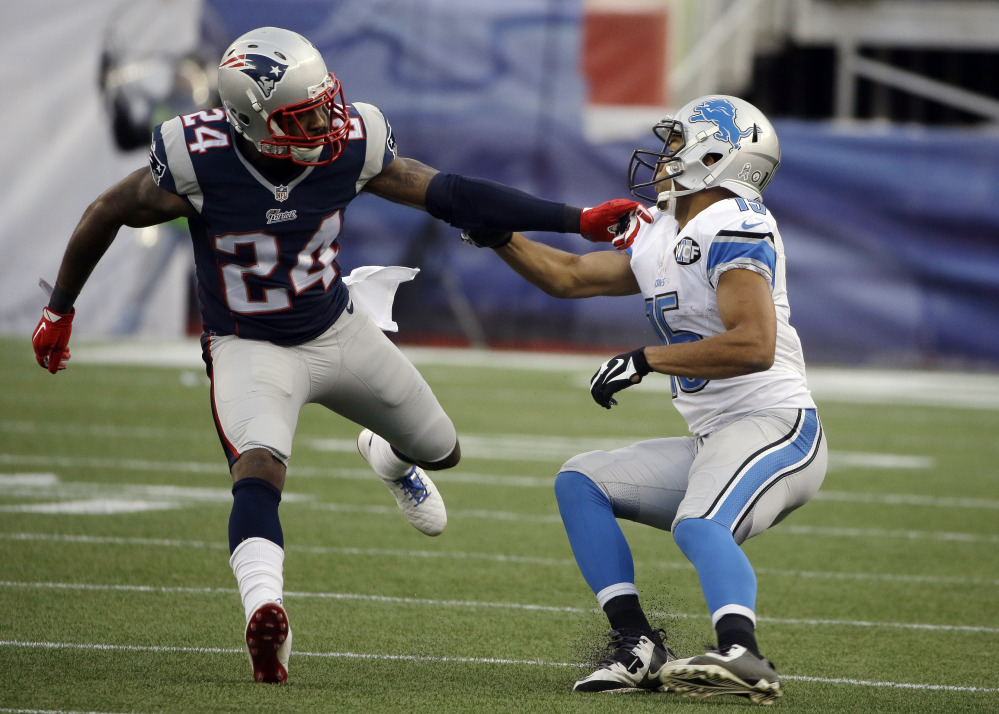 New England Patriots cornerback Darrelle Revis (24) defends against Detroit Lions wide receiver Golden Tate, right, in the second half of a game in Foxborough, Mass. Revis' skills will be on display Saturday, when the Patriots host the Baltimore Ravens in a divisional playoff game.