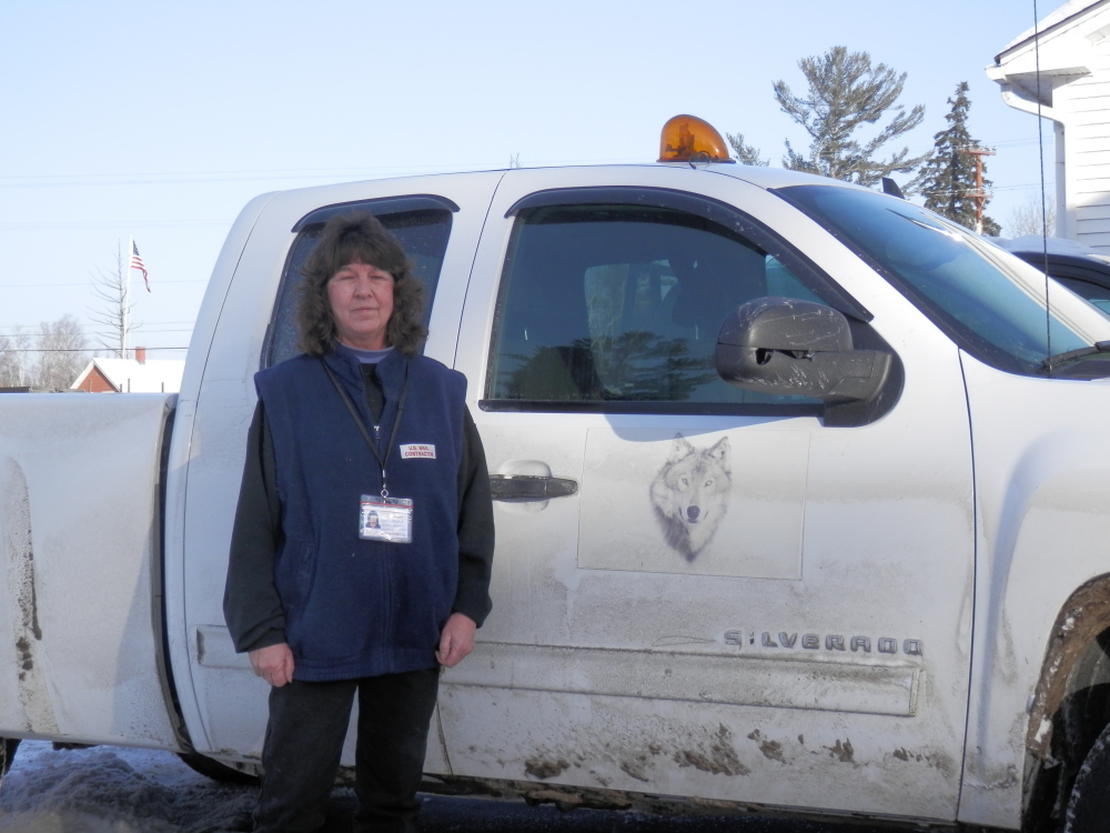 Mary Hughey, a contract driver for the U.S. Postal Service in Jackman, interrupted her route delivery to corrall two horses that had wandered on to Route 201 before they could pose a risk to traffic.