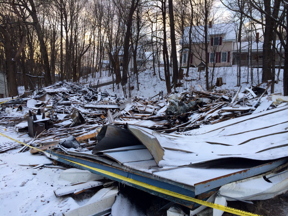 A pile of rubble is all that remained Friday of a two-family home on Water Street in Oakland following a fire Thursday. Town officials ordered the building razed after the fire was extinguished.