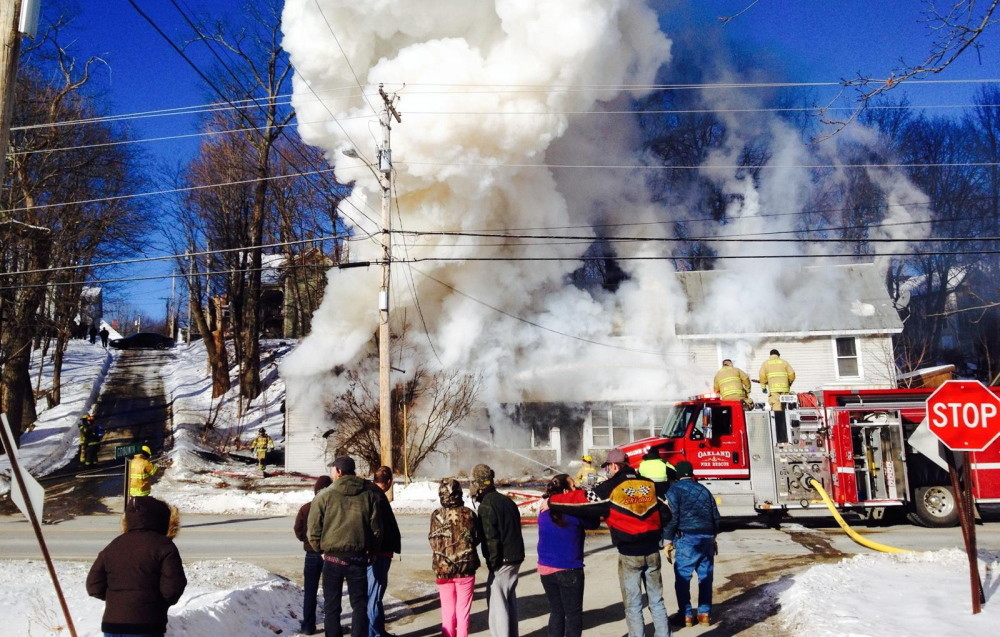 Firefighters respond to a home fire on Water Street on Thursday morning,