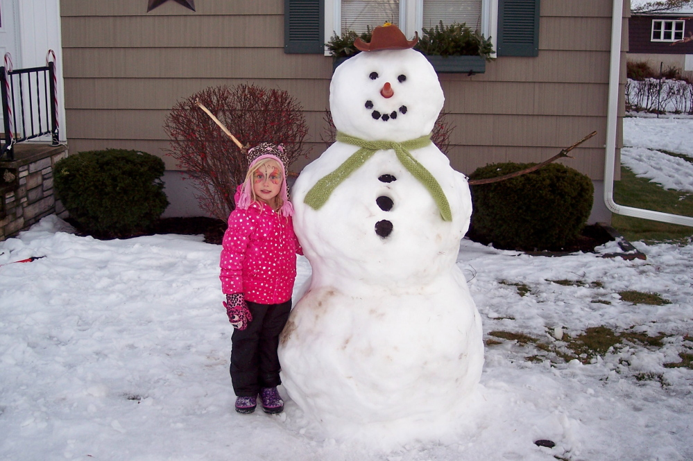 Addison Pelletier, 4, with the snowman that she and her father made recently in Augusta.  Submitted by Louise Pelletier
