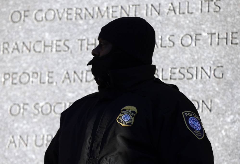 A police officer stands outside the federal courthouse in Boston on Monday for the first day of jury selection in the trial of Boston Marathon bombing suspect Dzhokhar Tsarnaev. Security measures are extraordinary for the terror trial.