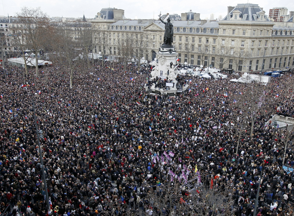 """Hundreds of thousands of people gather Sunday on the Place de la Republique to be part of the solidarity march in the streets of Paris, which became """"the capital of the world"""" for a day."""